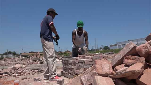 """""""Brick by Brick"""" is providing jobs for many people in North City. Credit: KMOV"""