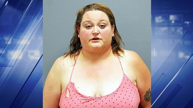 A Washington woman is accused of attempting to spit on officers while she refused to leave her car as it was being towed. (Credit: Franklin County jail)