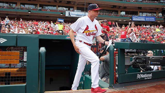 St. Louis Cardinals interim manager Mike Shildt heads out to deliver the lineup card before the start of a baseball game against the Cincinnati Reds Sunday, July 15, 2018, in St. Louis. (Credit: AP)