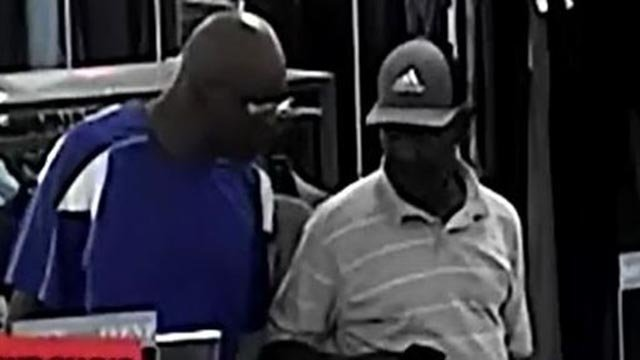 Surveillance image of two suspects accused of stealing watches from Saks Off 5th (Credit: Chesterfield Police Department)