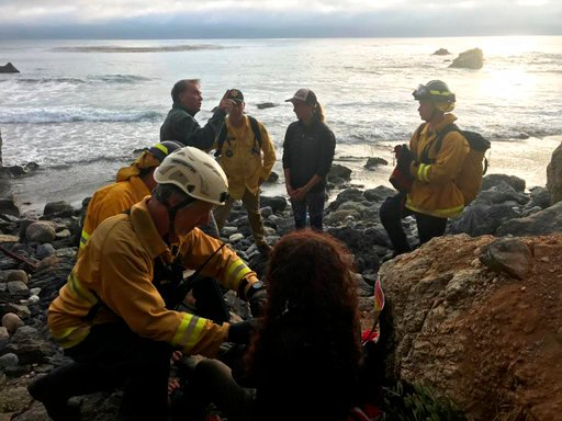 In this Friday, July 13, 2018, photo posted on the Monterey County, Calif., Sheriff's Office Twitter feed, authorities tend to Angela Hernandez, foreground center, after she was rescued, in Morro Bay, Calif.  (AP Images)