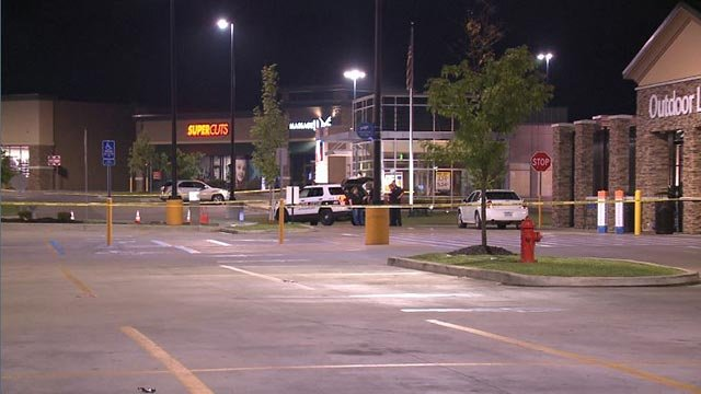 Crime scene tape and officers in the Kenrick Plaza Shopping Center (Credit: KMOV)
