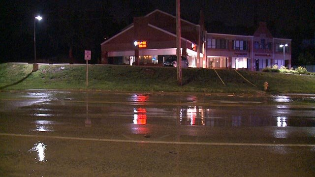 Water on Manchester Road following a water main break (Credit: KMOV)