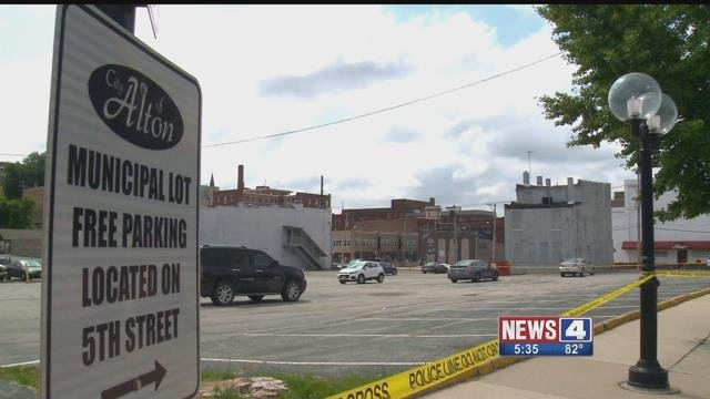 Crime scene tape surrounds a parking lot in Alton, Illinois where a deadly hit-and-run left 1 dead Sunday. (Credit: KMOV)