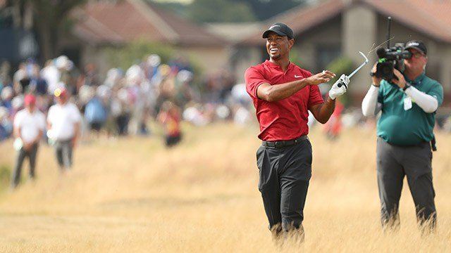 Tiger Woods of the US plays out of the rough on the 11th fairway during the final round for the 147th British Open Golf championships in Carnoustie, Scotland, Sunday, July 22, 2018. (AP Photo/Peter Morrison)