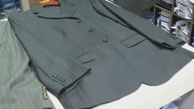 A suit jacket on a table at Men's Wearhouse (Credit: KMOV)