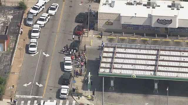 Protesters outside the BP station on Thursday, July 26. (KMOV)