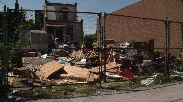 The trash is been dumped in a lot in the Dutchtown neighborhood of south city. (Credit: KMOV)