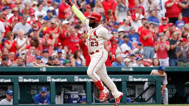 St. Louis Cardinals' Marcell Ozuna rounds the bases after hitting a grand slam during the first inning of a baseball game against the Chicago Cubs Saturday, July 28, 2018, in St. Louis. (AP Photo/Jeff Roberson)