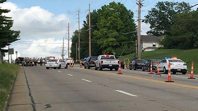 Crime scene investigators process the scene of a double shooting in Jennings (Credit: KMOV)