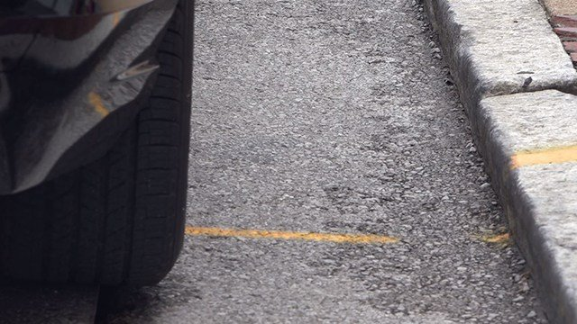 City officials say drivers can't be parked more than 12-inches from the curb or else they're breaking the law. (Credit: KMOV)