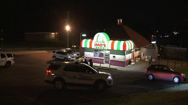 Crime scene tape outside the Imo's Pizza on Airport Road in Ferguson (Credit: KMOV)