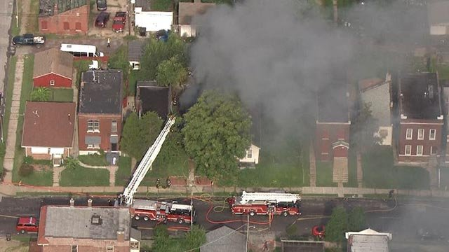 Firefighters on South Compton Monday (Credit: KMOV)