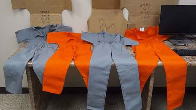 Image shows the child's prison uniforms confiscated by police