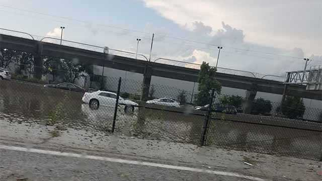 A car trapped in the flood waters near I-70 Outer Road near Lambert Airport (Credit: News 4 Viewer)