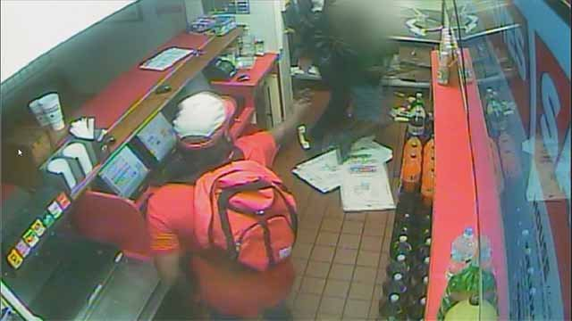 Surveillance video has been released of an Imo's Pizza manager being shot during a robbery attempt in Ferguson that occurred Sunday night. Credit: Ferguson PD