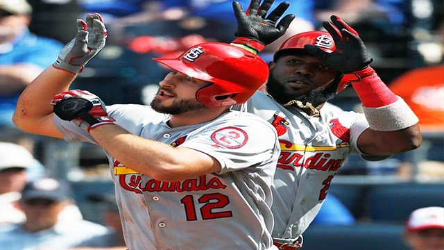 St. Louis Cardinals' Paul DeJong (12) celebrates with Marcell Ozuna (23) after hitting a two-run home run in the ninth inning of a baseball game against the Kansas City Royals at Kauffman Stadium in Kansas City, Mo., Sunday, Aug. 12, 2018. (AP Photo/Colin