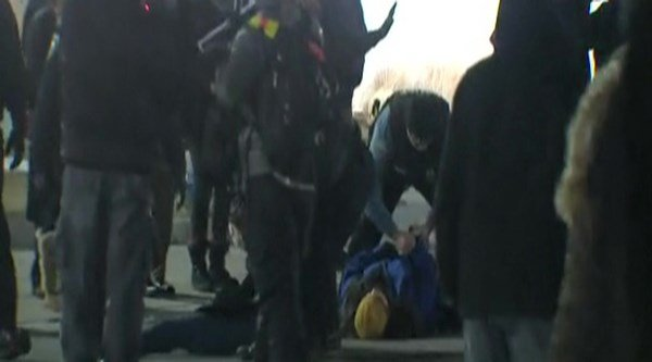 A person being taken into custody outside the Ferguson Police Department March 4