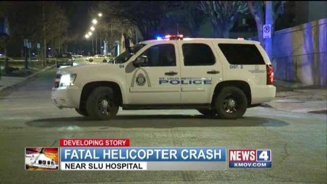 Police investigate the scene of a fatal helicopter crash near St. Louis University Hospital.