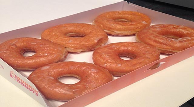 A 6-pack of Dunkin' Donuts original glazed donuts is pictured.