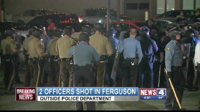 Two police officers shot outside the Ferguson, Missouri Police Department.