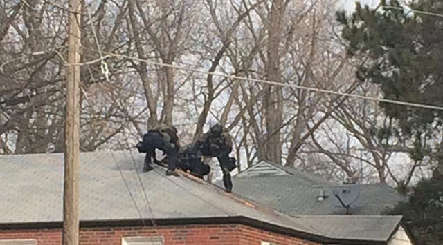 A SWAT team has geared up outside a home in Ferguson in reference to an officer shooting from overnight, according to St. Louis County Police.