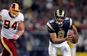 St. Louis Rams quarterback Sam Bradford, right, scrambles away from Washington Redskins defensive end Adam Carriker during the first quarter of an NFL football game Sunday, Oct. 2, 2011, in St. Louis. (AP Photo/Jeff Roberson) By Jeff Roberson