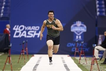 INDIANAPOLIS, IN - FEBRUARY 22: Former Texas A&M offensive lineman Jake Matthews runs the 40-yard dash during the 2014 NFL Combine at Lucas Oil Stadium on February 22, 2014 in Indianapolis, Indiana. (Photo by Joe Robbins/Getty Images) By Joe Robbins