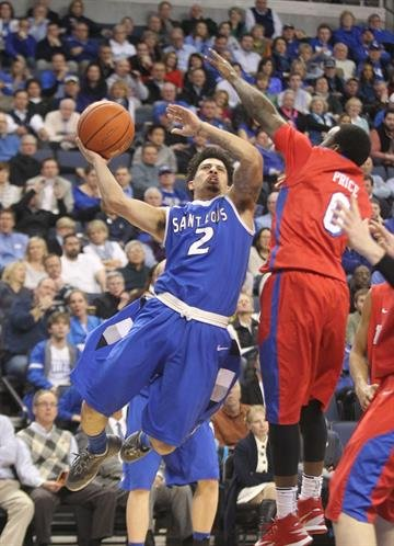 Saint Louis University Billikens Austin McBroom throws the basketball up past Dayton Flyers Khari Price in the first half at the Chaifetz Arena in St. Louis on March 5, 2014.   UPI/Bill Greenblatt By BILL GREENBLATT
