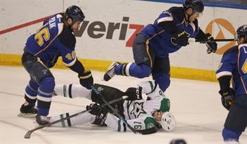 St. Louis Blues Roman Polak (46) of the Czech Republic and Ian Cole run over Dallas Stars Ryan Garbutt in the first period at the Scottrade Center in St. Louis on March 11, 2014. UPI/Bill Greenblatt By BILL GREENBLATT