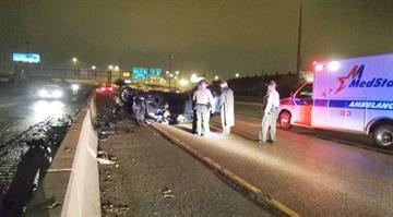 Accident reconstruction examine the scene of a rollover wreck. By KMOV Web Producer