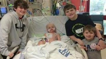 Josh Hardy is seen in the hospital in this undated photo with family members from the SaveJosh Facebook page. With permission from William Burns. By KMOV.com staff