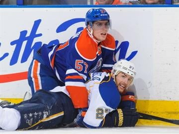 EDMONTON, AB - DECEMBER 21: David Perron #57 of the Edmonton Oilers checks Alex Pietrangelo #27 of the St Louis Blues during an NHL game at Rexall Place on December 21, 2013 in Edmonton, Alberta, Canada. (Photo by Derek Leung/Getty Images) By Derek Leung
