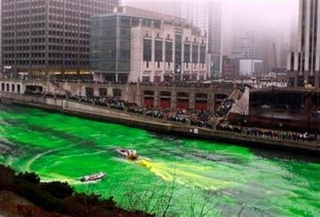 People watch as the Chicago River is dyed green in Chicago, Saturday, March 13, 2010 as part of Chicago's celebration of St. Patrick's Day. (AP Photo/Nam Y. Huh) By Nam Y. Huh