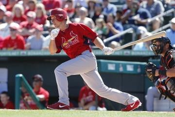 JUPITER, FL - MARCH 1: Mark Ellis #3 of the St Louis Cardinals hits the ball against the Miami Marlins during a spring training game at Roger Dean Stadium on March 1, 2014 in Jupiter, Florida. (Photo by Joel Auerbach/Getty Images) By Joel Auerbach