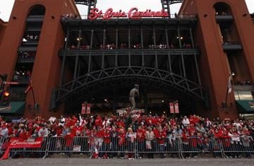 ST. LOUIS, MO - OCTOBER 30:  St. Louis Cardinals fans celebrate outside Busch Stadium during a parade celebrating the team's 11th World Series championship October 30, 2011 in St. Louis, Missouri. (Photo by Whitney Curtis/Getty Images) By Whitney Curtis