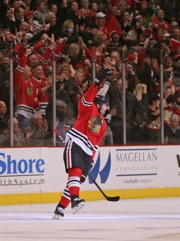 CHICAGO, IL - MARCH 19: Duncan Keith #2 of the Chicago Blackhawks celebrates his first period goal against the St. Louis Blues at the United Center on March 19, 2014  in Chicago, Illinois.(Photo by Jonathan Daniel/Getty Images) By Jonathan Daniel