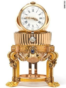 The diamond mechanism opens the egg to reveal a Vacheron Constantin watch inside. The gold watch with diamond hands is hinged to stand upright. By Stephanie Baumer