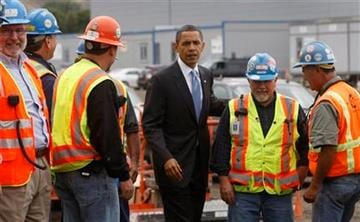 President Obama talks with workers as he tours Solyndra Inc. in Fremont, Calif., Wednesday, May 26, 2010. Solyndra is a solar panel manufacturing facility. (AP Photo/Paul Chinn, pool)