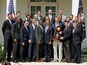 President Barack Obama poses with members of the NCAA basketball champion Duke Blue Devils in the Rose Garden of the White House in Washington Thursday, May 27, 2010. (AP Photo/Alex Brandon)