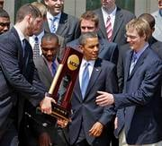 President Barack Obama lines up with members of the NCAA basketball champion Duke Blue Devils for a team photo, Thursday, May 27, 2010, in the Rose Garden of the White House in Washington. (AP Photo/Alex Brandon)