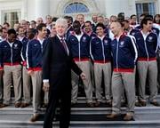Former President Bill Clinton comments on the shoes of the U.S. World Cup soccer team as they wait for President Barack Obama under the North Portico of the White House in Washington, Thursday, May 27, 2010. (AP Photo/Susan Walsh)