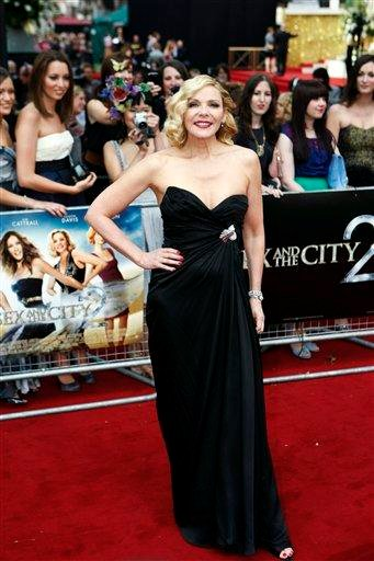Actress Kim Cattrall poses for the photographers as she arrives for the British premiere of her film 'Sex and the City 2', at a central London cinema, on Thursday, May 27, 2010. (AP Photo/Lefteris Pitarakis) By Lefteris Pitarakis
