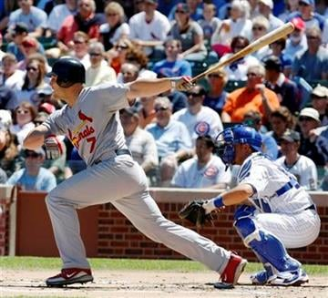 St. Louis Cardinals' Matt Holliday hits a single off Chicago Cubs starting pitcher Randy Wells during the first inning of a baseball game Friday, May 28, 2010 at Wrigley Field in Chicago. (AP Photo/Charles Rex Arbogast) By Charles Rex Arbogast