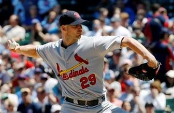 St. Louis Cardinals starting pitcher Chris Carpenter delivers during the first inning of a baseball game against the Chicago Cubs, Friday, May 28, 2010 at Wrigley Field in Chicago. (AP Photo/Charles Rex Arbogast) By Charles Rex Arbogast