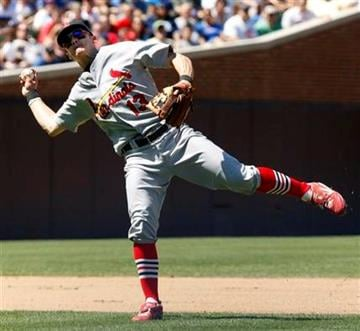 St. Louis Cardinals shortstop Brendan Ryan throws to first getting the out on Chicago Cubs' Marlon Byrd during the fourth inning of a baseball game, Friday, May 28, 2010 at Wrigley Field in Chicago. (AP Photo/Charles Rex Arbogast) By Charles Rex Arbogast