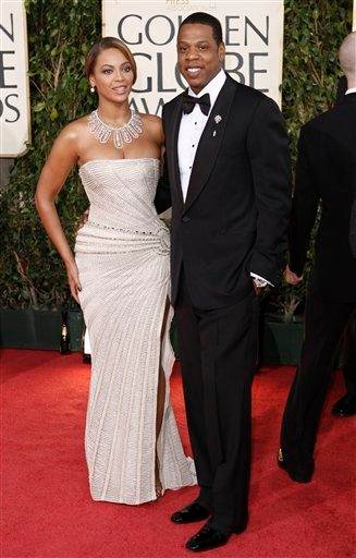 FILE - In this Jan. 11, 2009 file photo, Beyonce, left, is joined by husband Jay-Z, as she arrives at the 66th Annual Golden Globe Awards in Beverly Hills, Calif. (AP Photo/Matt Sayles, file) By Matt Sayles
