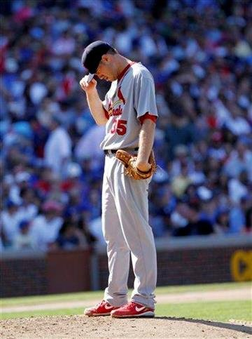 St Louis Cardinals starting pitcher Adam Ottavino reacts after giving up the  third run of the fourth inning in a baseball game against the Chicago Cubs  on Saturday, May 29, 2010, in Chicago. (AP Photo/Charles Cherney) By Charles Cherney