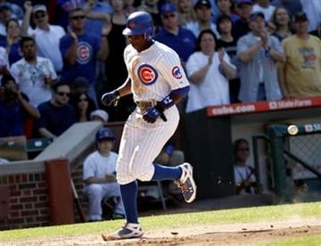 Chicago Cubs' Alfonso Soriano scores ahead of the throw in the fourth  inning against the St. Louis Cardinals during a baseball game on Saturday, May 29, 2010, in Chicago. (AP Photo/Charles Cherney) By Charles Cherney