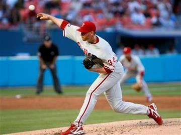 Philadelphia Phillies' Roy Halladay delivers a pitch during the second inning of a baseball game against the Florida Marlins, Saturday, May 29, 2010, in Miami. (AP Photo/Wilfredo Lee) By Wilfredo Lee